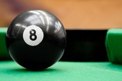 Pool Ball Number Eight. Focused pool billiard ball number eight ready to be played stock photos