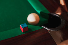 Pool ball opposite to a pocket. Stock Image