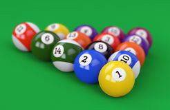 Pool ball pyramid on green background Stock Photo