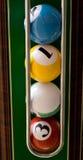 Pool balls. On green felt background Stock Photo