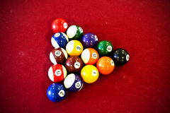 Pool Balls. Red pool table with colorfull balls Royalty Free Stock Photos