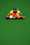 Pool balls. On green pool table Royalty Free Stock Photo