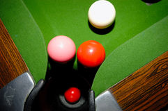 Pool Balls. 3 pool balls near a pocket and one in the pocket Royalty Free Stock Photos