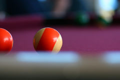 Pool balls. Up close with lens focus on one ball bluring the background Stock Images