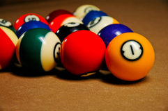 Pool balls on a billiard table. A set of racked pool balls on a billiard table before a game begins Stock Images