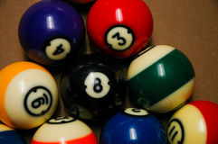 Pool balls on a billiard table. A set of racked pool balls on a billiard table Stock Photo