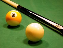Pool balls and cue Royalty Free Stock Photos