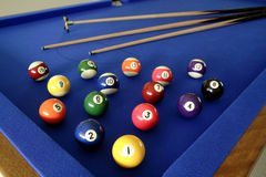 Pool balls and cues Stock Photos