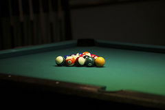 Pool balls on green pool table Stock Images