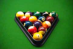 Pool balls on green snooker table Royalty Free Stock Images