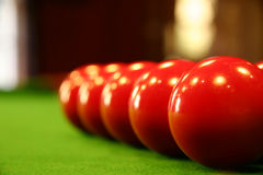Pool balls on a green table. Colored billiard balls on a green billiard table Royalty Free Stock Photography