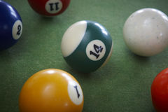 Pool balls on a green table. Royalty Free Stock Photography