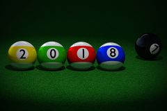 Pool balls with 2018 New Year date imprinted. 3D rendering of four striped pool balls with 2018 New Year date imprinted, and black ball with number seven Stock Images