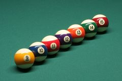 Pool balls from number 09 to 15. In pool table stock images
