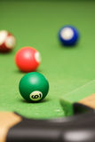 Pool balls on a pool table. Four pool balls on a green filt covered pool table Royalty Free Stock Photo