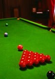 Pool balls on pool table. Red Pool balls on a green felt top pool table Royalty Free Stock Photography