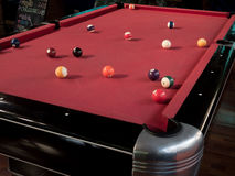 Pool balls. On a red table Royalty Free Stock Photos