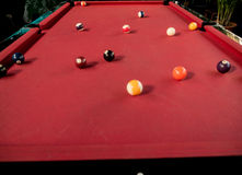 Pool balls. On a red table Stock Images