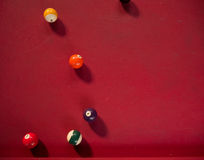 Pool balls on a red table. Shot of Pool balls on a red table Stock Photography