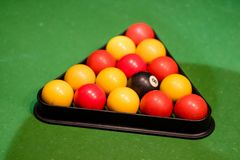 Pool balls set up in the triangle. Ready on the green cloth Stock Photography