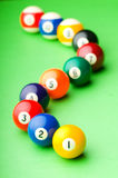 Pool balls on the table. Pool balls on the green  table Stock Photography