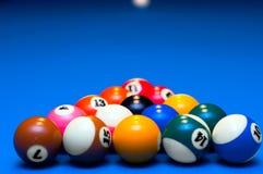 pool balls triangle on billiard table. Pool balls triangle on blue background billiard table Royalty Free Stock Photos