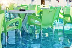 Pool bar with arm chairs Stock Photo