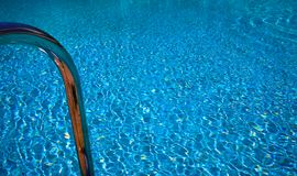 Pool with bathing ladder royalty free stock photography