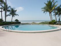 Pool on the beach. Pool with ocean/sea/Gulf view Stock Photography
