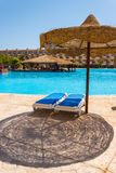 The pool, beach umbrellas and the Red Sea in Egypt Stock Image