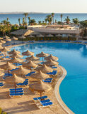 The pool, beach umbrellas and the Red Sea in Egypt Stock Photography