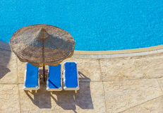 The pool, beach umbrellas and the Red Sea in Egypt Royalty Free Stock Photos