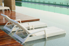 Pool bed beside swimming pool Royalty Free Stock Photography