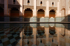 Pool in Ben Youssef Madrasa. MARRAKECH, MOROCCO, MAY 10, 2013 : The Ben Youssef Madrasa was an Islamic college in Marrakesh, Morocco, named after the Almoravid Stock Image