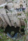 Pilgrims in The Pool of Bethesda in the Muslim Quarter of Jerusalem stock images