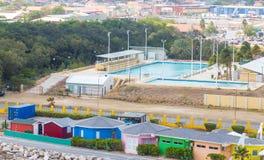Pool Beyond Colorful Cabanas Stock Image