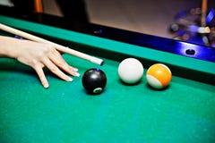 Pool Billard shoot. Pool billard strike ball on green surface Stock Image