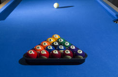 Pool billiard balls in a plastic rack - commonly used starting p. All billiard balls focused on pool Royalty Free Stock Images