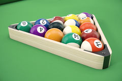 Pool billiard balls in a wooden rack, commonly used starting position, 3D illustration on green background. Royalty Free Stock Photos