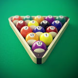 Pool billiard balls in a wooden rack. 3d illustration Royalty Free Stock Photography
