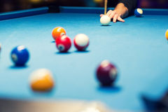 Pool billiard, hand aiming the cue ball Royalty Free Stock Photo