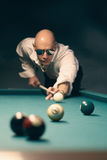 Pool billiard player. Handsome stylish man playing pool billiards, selective focus on face Royalty Free Stock Photography