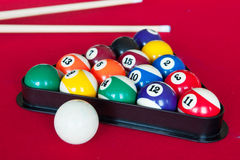 Pool billiards. On red table to play Royalty Free Stock Photography