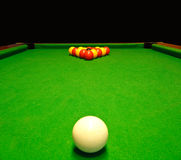 Pool billiards table. A green cloth billiards or pool table with english league red and yellow balls Stock Photo