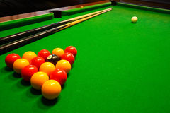 Pool billiards table. A green cloth billiards or pool table with english league red and yellow balls Stock Photography