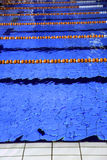 Pool with blue water and the swimming lanes Royalty Free Stock Photo