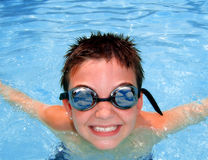 Pool Boy. A happy eight year old in a pool during summer vacation Stock Photography