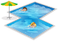 A pool with a boy and a girl swimming Royalty Free Stock Photos