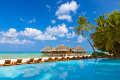 Pool and cafe on Maldives beach Stock Photo