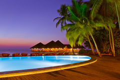 Pool and cafe on tropical Maldives island Royalty Free Stock Photography
